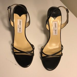 Jimmy Choo strapping heels. Heel height 4 inches.